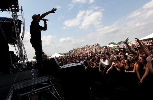 Evidence and fans soaked up the sunshine at last year's Soundset festival, which wasn't to last. / Courtney Perry for Star Tribune