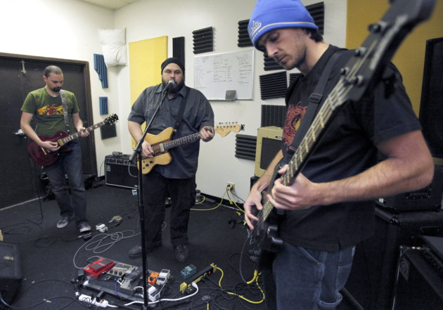 Tripping Icarus found time to rehearse in 2010 during the NFL season. From left: Andrew Reiner, Jesse Damien Revel and Chris Kluwe. / Tom Wallace, Star Tribune