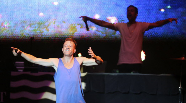 "Macklemore, backed by Ryan Lewis, only delivered nine songs in Saturday's fair grandstand concert -- or eight if you don't count ""Can't Hold Us"" twice. / Kyndell Harkness, Star Tribune"