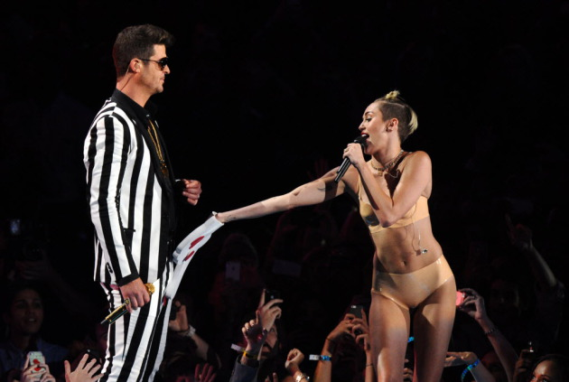 "Robin Thicke and Miley Cyrus performed together in the ""Twerk Heard 'Round the World"" appearance at the MTV Video Music Awards in September. /  Charles Sykes, Invision, AP"
