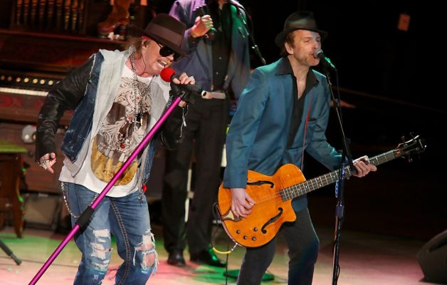 Tommy Stinson, right, with Axl Rose in San Francisco in 2012. / Barry Brecheisen, Associated Press