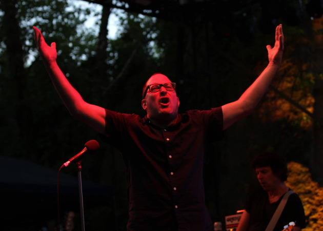 Craig Finn occasionally imitated the Minnesota Zoo stage's daytime stars (birds) in Saturday's sold-out Hold Steady concert. / Monica Herndon, Star Tribune
