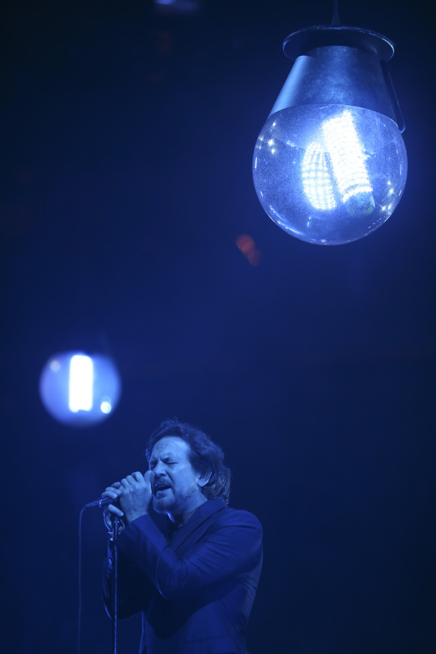 A low-lit Eddie Vedder near the start of Sunday's Pearl Jam concert at Xcel Energy Center. / Jeff Wheeler, Star Tribune