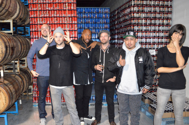 Like wolves guarding the hen house: Members of Doomtree hit the Surly brewing facility recently to oversee quality control. / Photo courtesy Surly