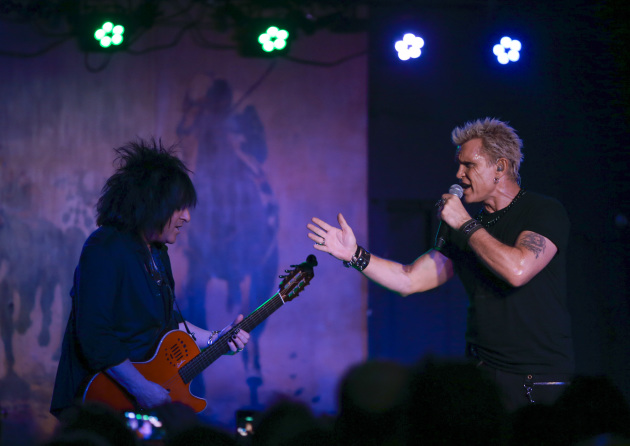 With longtime guitarist Steve Stevens by his side, Billy Idol played a short set Monday at the Turf Club in St. Paul. / Photos by Jeff Wheeler, Star Tribune