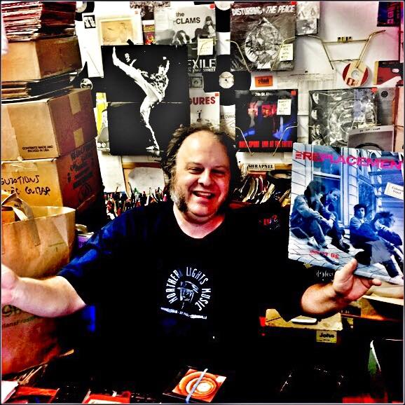 "John Kass holding the last of the original ""Let It Be"" vinyl. / Photo by Chris Strouth"