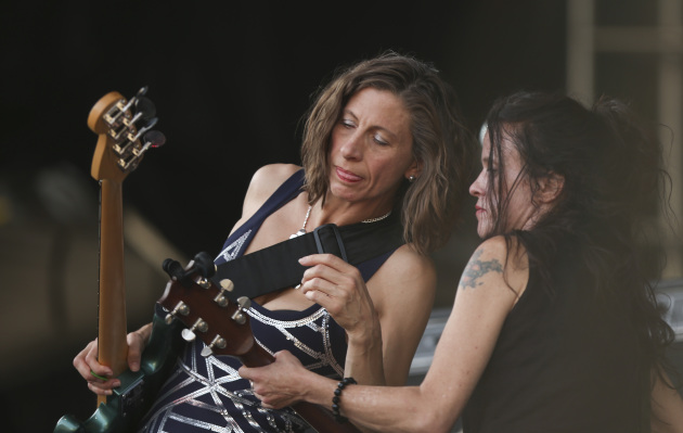 Maureen Herman, left, and Kat Bjelland conferred between songs when Babes in Toyland played Rock the Garden in June outside Walker Art Center in Minneapolis. / Jeff Wheeler, Star Tribune