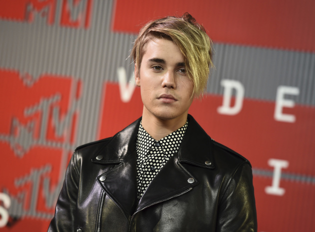 Justin Bieber looked all grown-up and quite pretty as he arrived at the MTV Video Music Awards in August. (Photo by Jordan Strauss/Invision/AP, File)