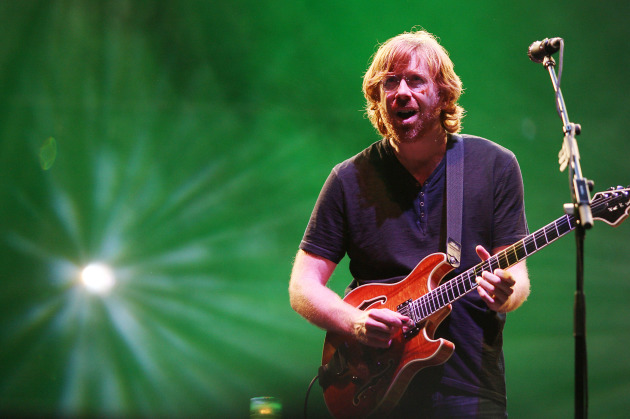 Trey Anastasio played to a green backdrop when Phish played Bonnaroo in 2009, and there should be a lot more green stuff around when his band hits Xcel Center. / Amanda Schwab, AP/Starpix