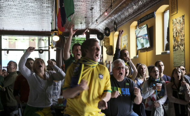 Nomad World Pub patrons watching World Cup soccer in 2014 might also react this way to news the bar is for sale. / Star Tribune file
