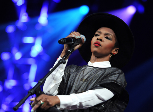 Lauryn Hill performs at an Amnesty International concert in New York in 2014. / Evan Agostini/Invision/AP)