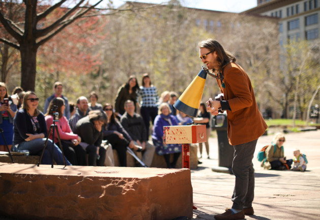 """Jeremy Messersmith set up shop in St. Paul's Mears Park at lunchtime Monday for the second stop on his """"micro-tour."""" / Jeff Wheeler, Star Tribune"""