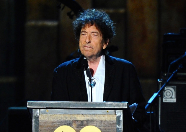 Bob Dylan at the podium for the MusiCares Person of the Year ceremony in 2015. / Photo by Vince Bucci, Invision/AP
