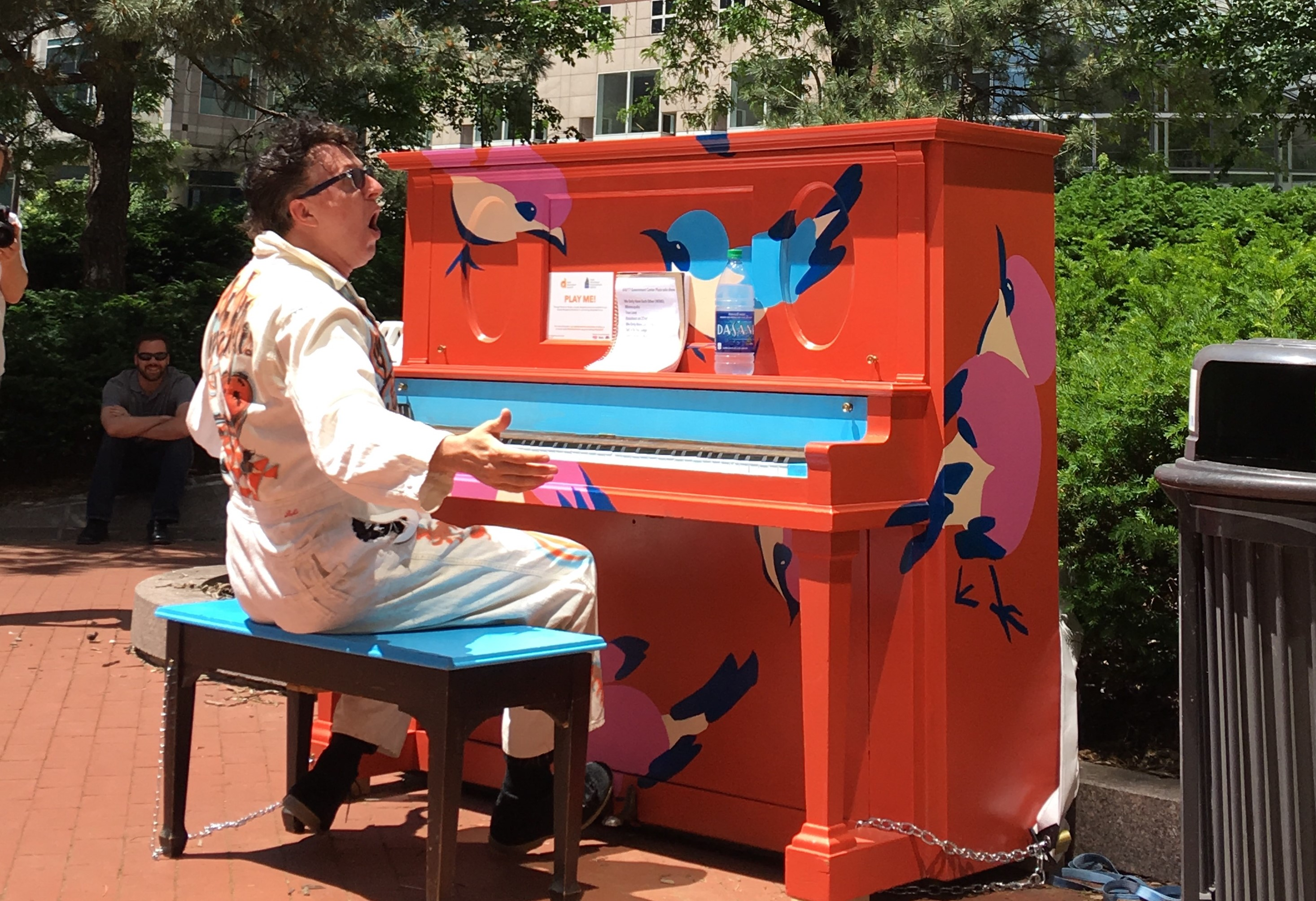 Mark Mallman performed outside the Government Center to promote Pianos on Parade.