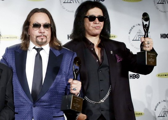 Ace Frehley and Gene Simmons appeared on stage but would not perform together when Kiss finally got into the Rock and Roll Hall of Fame in 2004. / PatrickMcMullan.com via AP Images