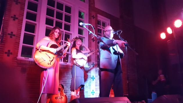 Mark Woodrich recently introduced Dusty Heart's Molly Dean and Barbara Jean at the Concert Club of Owatonna, aka Jefts Hall. / Photo by Keith Williams