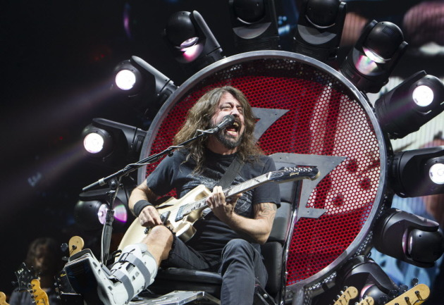 A hobbled but far from mellowed Dave Grohl with the Foo Fighters in 2015 at Xcel Energy Center. / Star Tribune file