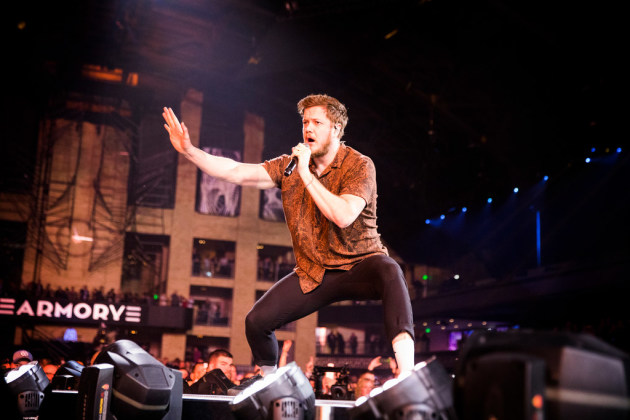 The Armory's facade made for a dramatic backdrop whenever Imagine Dragons singer Dan Reynolds worked the thrust stage Thursday night. / Leila Navidi, Star Tribune