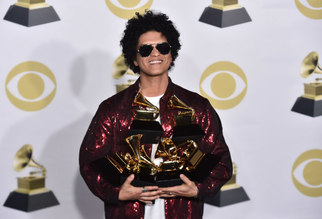 Bruno Mars cleaned up at the Grammy Awards last month. / Charles Sykes, Invision/AP