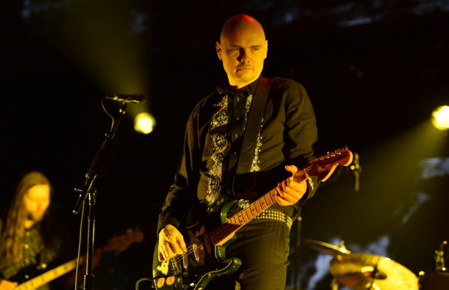 Billy Corgan will hopefully look more interested at Xcel Center in August than he does here when his remade Smashing Pumpkins played Los Angeles's KROQ Christmas concert in 2014. / John Shearer, Invision/AP
