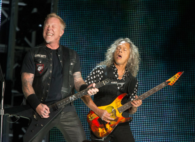 Metallica's James Hetfield and Kirk Hammett make their best face-melter faces at the Baltimore stop on their WorldWired Tour. / Owen Sweeney, Invision/AP