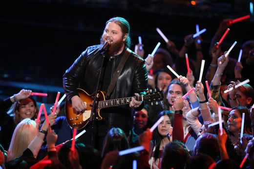 "Chris Kroeze hovered over ""The Voice"" audience singing ""Sweet Home Alabama"" on Monday. / Tyler Golden, NBC"
