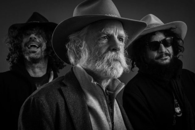 Bob Weir, center, may look like a sheriff in a Wyoming cattle county, but he's still rocking out with the hippies.
