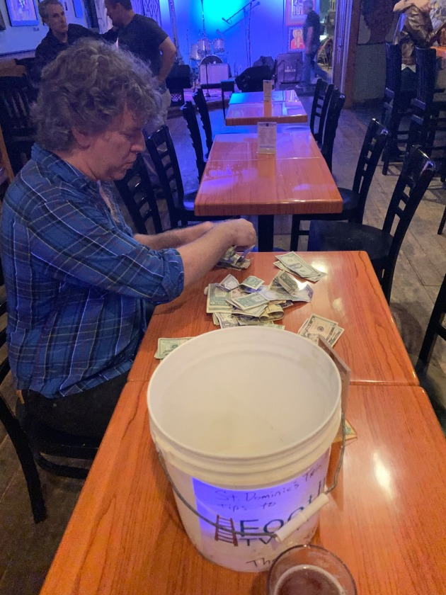 Terry Walsh counted up donations after a recent gig.