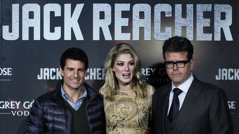 "Partners in crime. Tom Cruise, Rosamund Pike and Christopher McQuarrie at the Spanish premiere of ""Jack Reacher."" Associated Press."