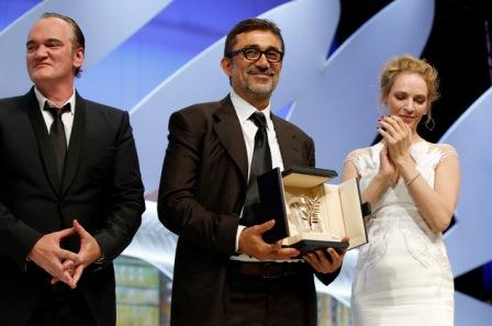 Director Nuri Bilge Ceylan, center, accepts the Palme d'Or from director Quentin Tarantino and Uma Thurman during the awards ceremony for the 67th international film festival in Cannes, France, last May 24. (AP Photo/Alastair Grant)