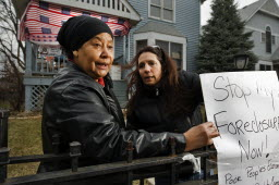 Honkala, right, protests a <a href=