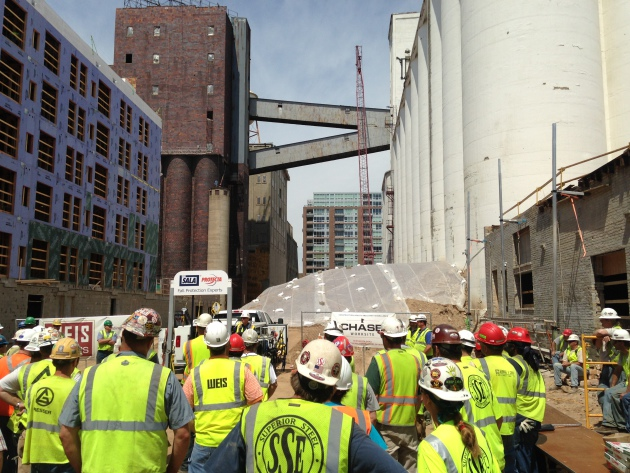 Workers at the A Mill Artists Lofts site in Minneapols gather for demonstration on fall safety.