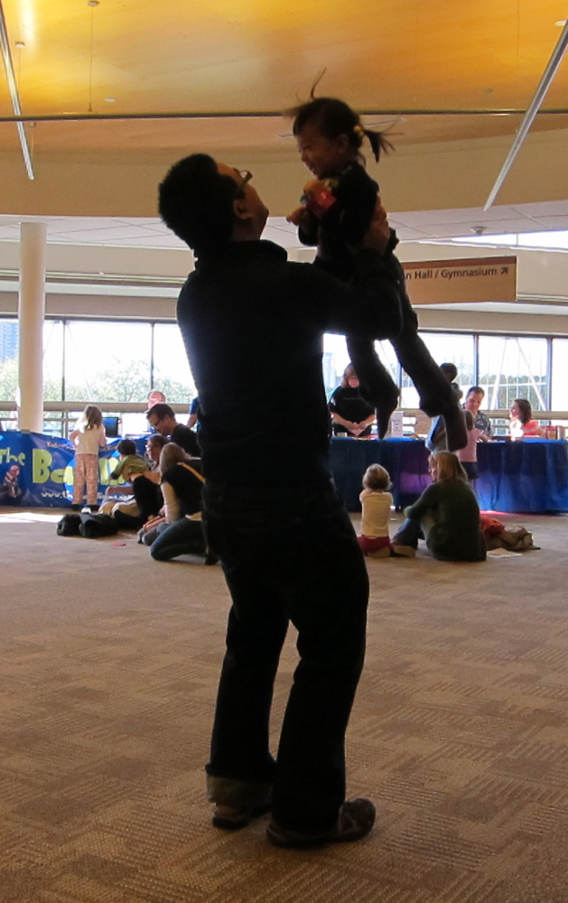 Sang Vo of Minneapolis twirled his daughter, Annabelle, in the Children's Pavilion, where the band The Bazillions played for the kids.