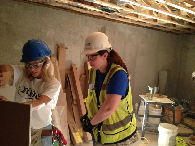 Kelly Thommes, left, and Sara Aulizia, work on the North Minneapolis home.