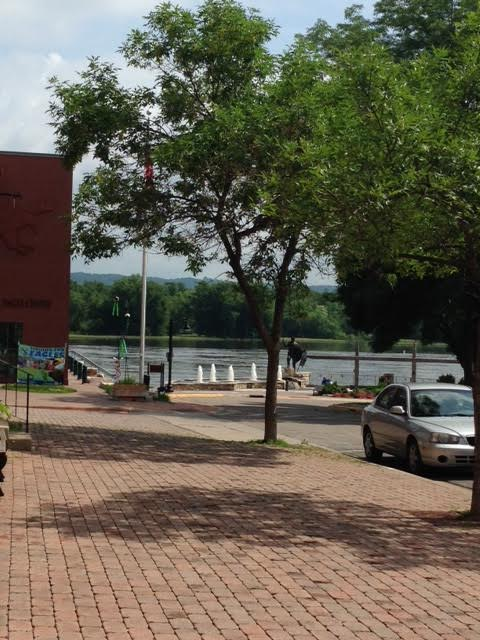 The swollen Mississippi rolls by, but not over, downtown Wabasha.