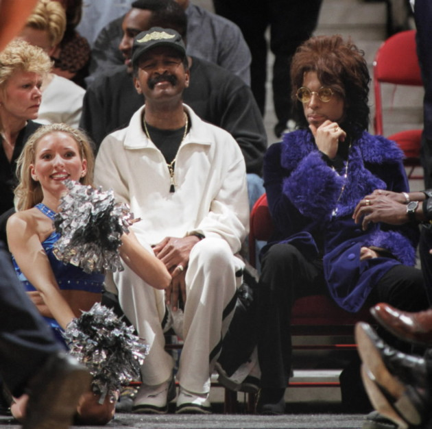 Prince showing his purple pride at a T'Wolves game with Larry Graham in 2000./ Star Tribune file photo