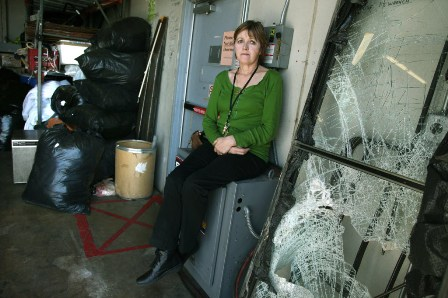 Patricia Gearin and the smashed door (Photo by Elizabeth Flores)