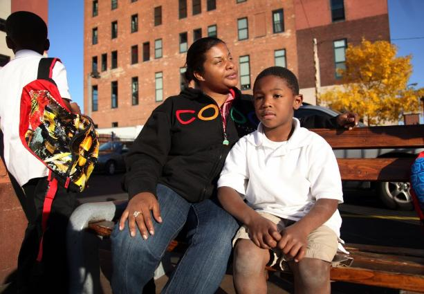 Theresa Saunders and her son Doobie Lenear, 6, wait for housing (photo by Renee Jones Schneider)