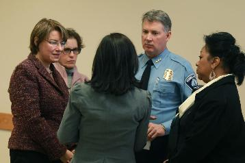 From left, U.S. Sen. Amy Klobuchar, City Attorney Susan Segal, Ambar Hanson of Casa de Esperanza, police Chief Tim Dolan and Sharon Brice of the Domestic Abuse Project  (photo by Elizabeth Flores)