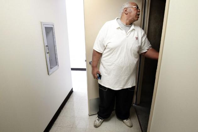 Security volunteer in public housing (file photo by Carlos Gonzalez)