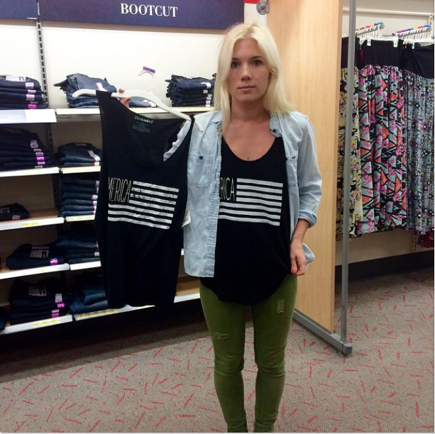 Melissa Lay posted this picture to Instagram on Monday. She's wearing her own design while holding up a virtually identical tee found at Target.