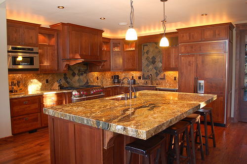 Cherry Wood Cabinets Granite Countertops Stainless Steel Liances For Years They Ve Been The Holy Trinity Of Materials In Upscale Kitchens