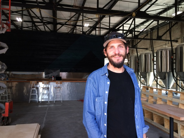 Able Seedhouse and Brewery founder Casey Holley in the soon-to-be-completed new space. (photo: Kristen Leigh Painter/Star Tribune)