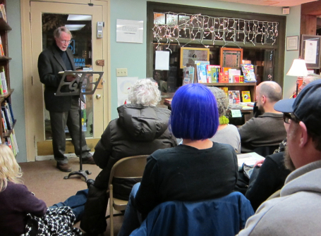 White hair, purple hair--Charles Baxter speaks to a standing-room-only crowd at Micawber's in St. Paul. 