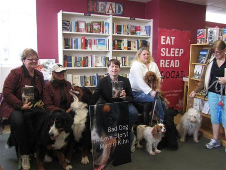 Martin Kihn, surrounded by dogs and readers, at the Bookcase in Wayzata. Photo by Linda White