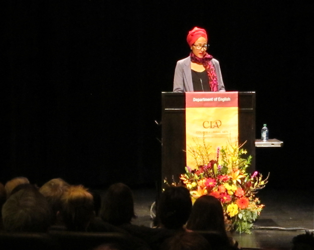 Zadie Smith speaking to an overflow crowd at the University of Minnesota.