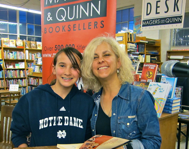 Kate DiCamillo meets a reader (and a fan) named Anna Wilkens at the World Book Night 2012 event at Magers and Quinn.