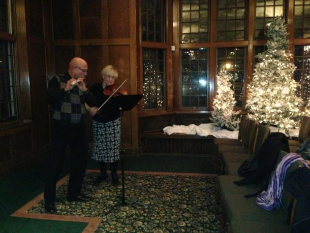 Flute and violin music at the December gathering of the Carol Connolly Readings for Writers.
