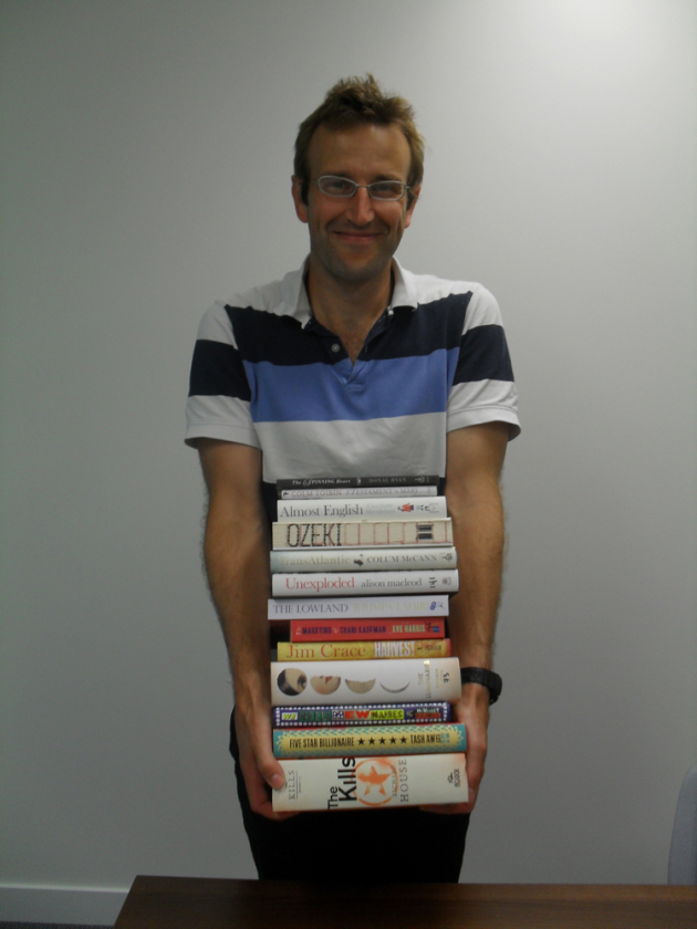 Robert Macfarlane, chairman of the Man Booker Prize committee, shows off the titles of this year's longlist.