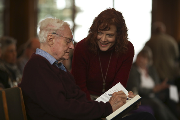 Robert Bly autographs a book for a fan before his appearance at the University Club on Tuesday night. Star Tribune photo by Jeff Wheeler